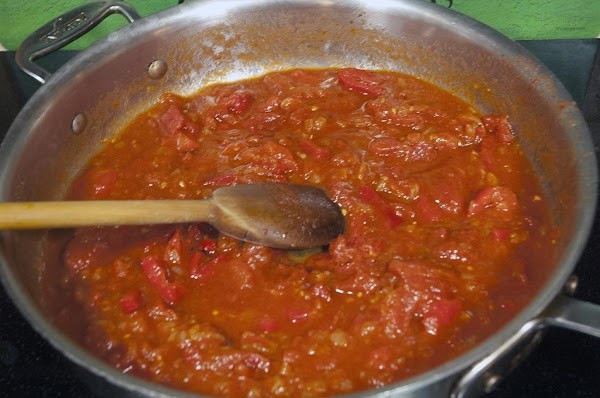 Reduce the heat to a slow simmer, and continue to cook, covered, for about...