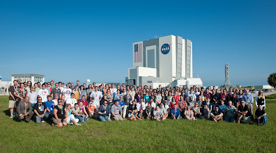 Photo: Juno launch Tweetup participants pose for a group photograph with NASA Administrator Charles Bolden with the Vehicle Assembly Building (VAB) in teh background, Friday, August 5, 2011, at Kennedy Space Center in Cape Canaveral, Fla. Select NASA Twitter followers attended the event which culminated in the launch of the Juno spacecraft.  Photo Credit:  (NASA/Bill Ingalls)