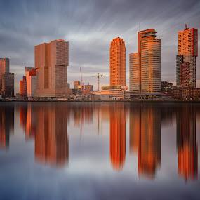 Rotterdam at sunset by Rémon Lourier - City,  Street & Park  Skylines ( highrise, reflection, rotterdam, sunset, holland, long exposure )