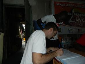 Photo: Will Ruddick and Alfred Sigo looking over BBN registrationhttp://koru.or.ke
