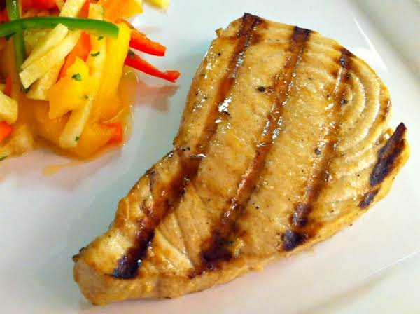 Grilled Marlin Steak On A White Plate With Vegetable Slaw.