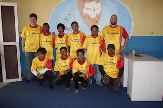 "Photo: Michael, standing on extreme left and Elias on extreme right also standing, with ""The Team"" with their jerseys!"
