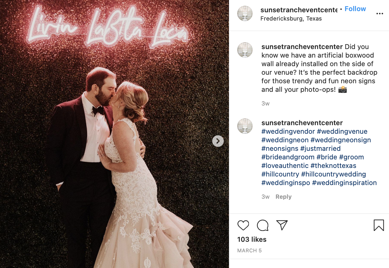 couple posing in front of the neon sign at their wedding