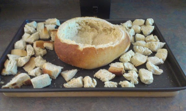 Prepare the bread by slicing off the top part of the loaf and using...