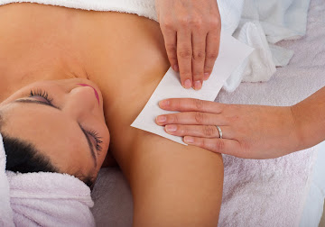 Lady having armpit waxed