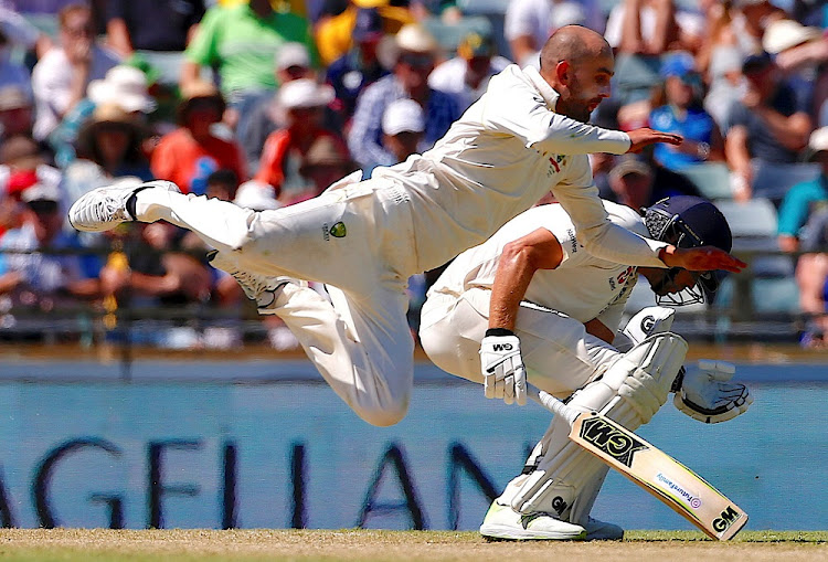 Unbeaten: England's Dawid Malan reacts as Australian Nathan Lyon dives but fails to take a catch during the first day of the third Ashes cricket test match in Perth, Australia, December 14 2017. Malan struck England's first century of the Ashes. Picture: REUTERS