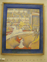 """Photo: Sunday morning brings our first museum stop, at the Orsay, where we start on the top floor - finding ourselves in the room with Seurat and the other pointillists. Here, Seurat's """"The Circus"""" from 1891. It is an excellent example of Divisionism: that it is possible to obtain brighter hues of color such as green, orange and purple, by a series of dots (or blobs) of both primary colors so that they are optically intermingled in the spectator's eye (rather than being pre-mixed)."""