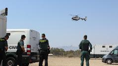 Efectivos de la Guardia Civil y helicóptero en el Puesto de Mando de Dreambeach.