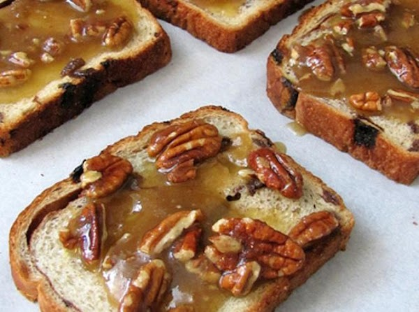 Place the bread on the paper. Combine the remaining ingredients and spread evenly on the...