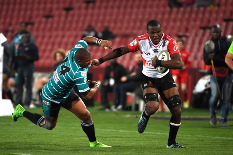 Hacjivah Dayimani of the Xerox Golden Lions beasts Ederies Arendse of the Tafel Lager Griquas during the Currie Cup match between Xerox Golden Lions XV and Tafel Lager Griquas at Emirates Airline Park on August 24, 2018 in Johannesburg, South Africa.