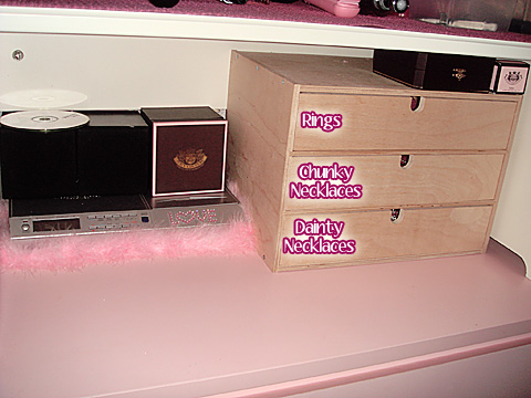 Third shelf: Stereo and little drawers for my excess accessories.
