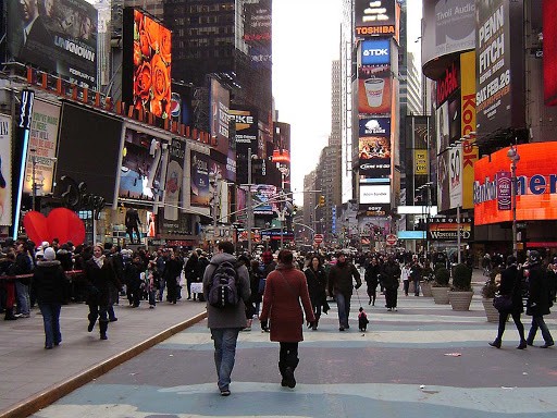 Broadway and Times Square in Manhattan teems with pedestrians.