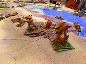 Photo: Gorghadra (near) and Zorog (far) slowly advance past the Planet Eater Stronghold.