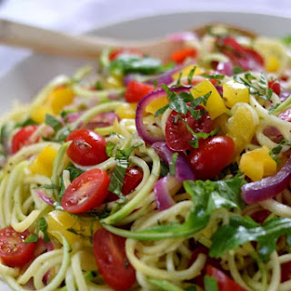 Zucchini Noodle Salad with Arugula and Apple Cider Vinegar Dressing.