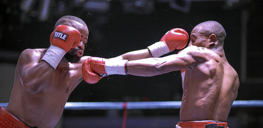 Sibusiso Zingange, right, exchanges leather with Ashley Dlamini in 2016 for the vacant ABU title in Boksburg, which Zingange won.