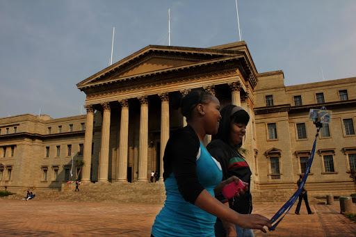 Students walking outside the Great Hall, Wits University. File photo.
