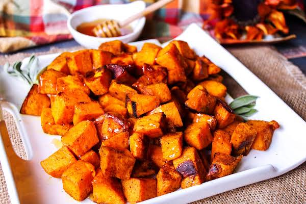 A Platter Of Roasted Sweet Potatoes With Honey.