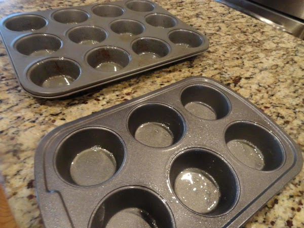 Preheat oven to 350 degrees. Spray one 12 cup and one 6 cup (or 3...