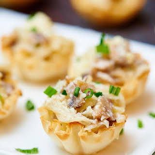 Mini Caramelized Onion, Mushroom, and Apple Tarts.