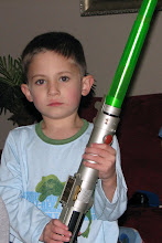 Photo: Reed with his force-action lightsaver - a favorite present, from the ever-popular Uncle Matt
