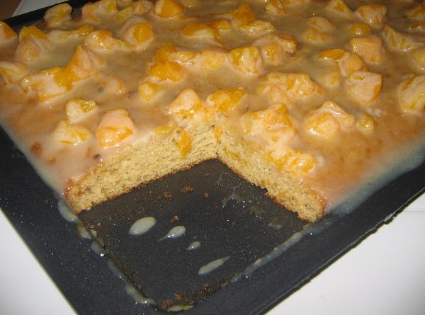 When cake/bars are out of the oven--Distribute the remaining peach pieces over hot cake/bars....