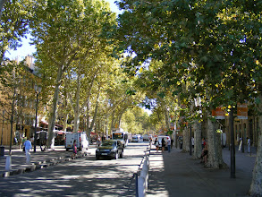 Photo: The Cours Mirabeau (which takes its name from an 18th century count of both renown and mixed reputation) is 480 yards long, 46 yards wide, and contains 445 plane trees planted at 11 yard intervals. One side of the street is populated by banks and businesses, and the other by restaurants and cafes.