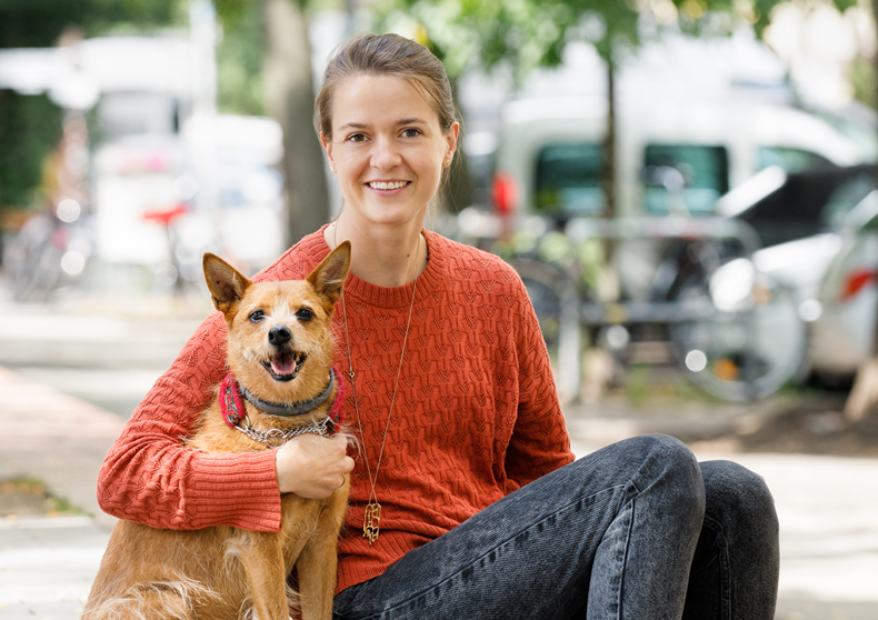 Dogo Founder, Rasa, and her dog, Ūdra, smile for the camera.