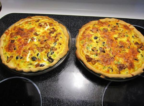 Chorizo And Potato Quiche With Black Olives And Green Onions.