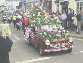 Photo: a classic mini pick-up bringing up the rear for the flower show