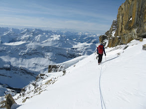 Photo: Traversing below the summit block to the snow gully.