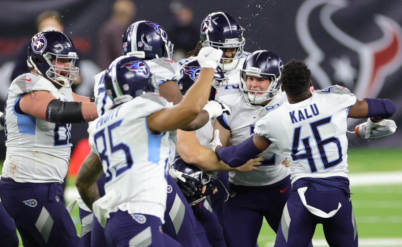 Cole McDonald #2 of the Tennessee Titans celebrates with teammates following a game against the Houston Texans at NRG Stadium on January 03, 2021 in Houston, Texas. (Photo by Carmen Mandato/Getty Images)