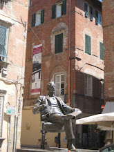 Photo: Puccini.  His birthplace, now a museum, in the background.