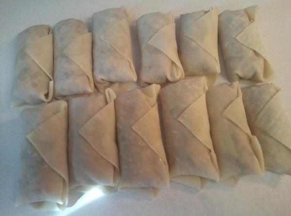 Fill each wrapper with 1 lg teaspoon of filling. I seal each of them with...