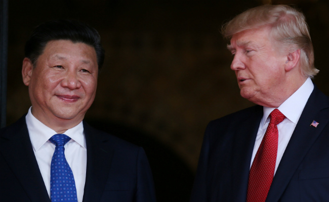 Xi Jinping and Donald Trump. Picture: REUTERS