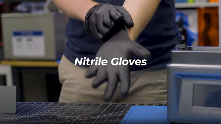 Nitrile or latex gloves are an essential precaution for any resin 3D printer maintenance.