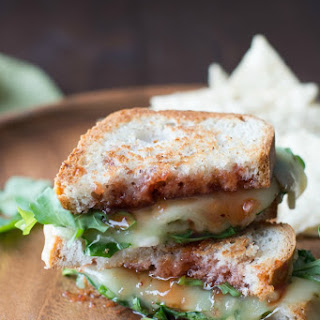 Pepper Jack Grilled Cheese Sandwich with Strawberry Hot Sauce and Arugula.