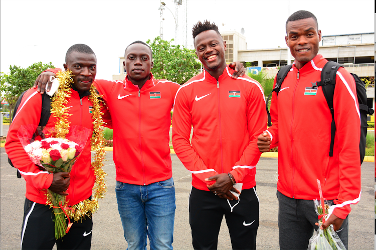 World relays silver medalists Hesbon Ochieng,Mike Mokamba,Mark Otieno and Elijah Mathew at JKIA on Tuesday after the team landed from Silesia, Poland.