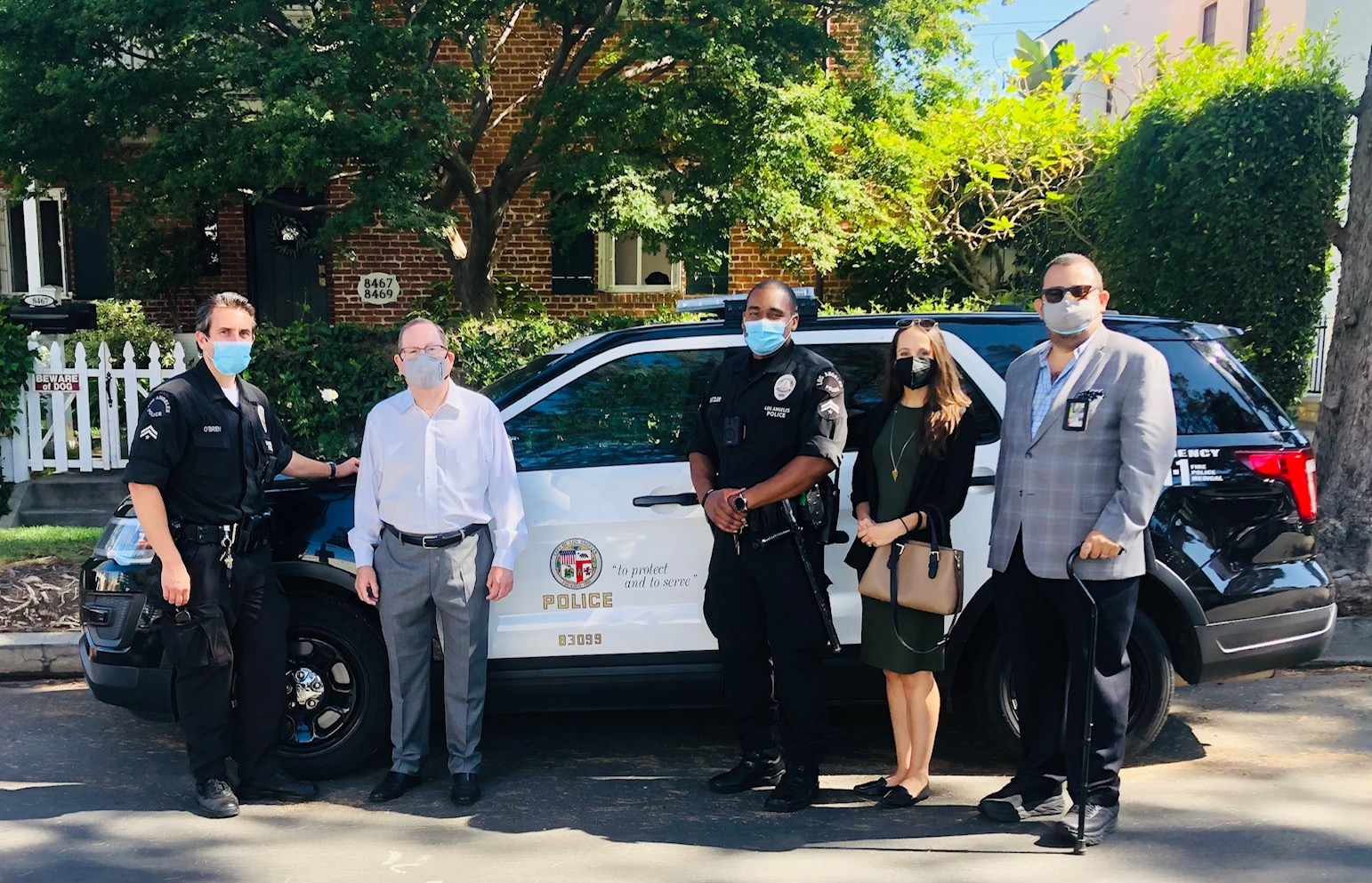 CD5 staff pose w LAPD Wilshire Division SLOs and patrol car