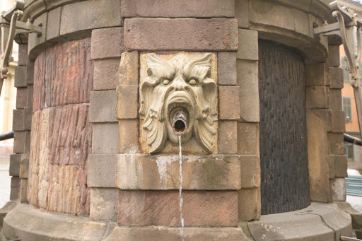 Fountain-gargoyle-in-Gamla-stan.jpg -  A gargoyle spouts water from a 15th century well in Stockholm's Gamla stan district.