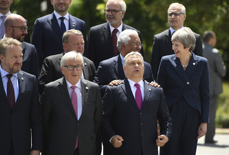 British Prime Minister Theresa May, European Commission President Jean-Claude Juncker and Hungarian Prime Minister Viktor Orban pose among other heads of state during the family photo at the EU-Western Balkans Summit in Sofia, Bulgaria.