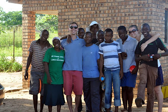 Photo: When Hilsinger and husband Jasen returned for a visit to his Peace Corps village, the group of boys he worked with gathered for a photo.