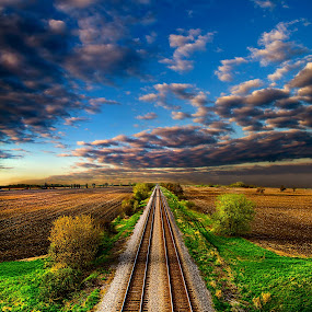 I Will Return by Phil Koch - Transportation Trains ( summer. spring, vertical, photograph, farmland, yellow, leaves, love, nature, autumn, snow, train, flowers, orange, twilight, agriculture, horizon, portrait, winter, environment, season, national geographic, serene, floral, inspirational, wisconsin, train tracks, natural light, phil koch, spring, sun, photography, farm, ice, horizons, inspired, clouds, office, green, scenic, morning, field, red, blue, sunset, peace, fall, meadow, earth, sunrise, landscapes, , HDR, Landscapes, vertical lines, pwc )