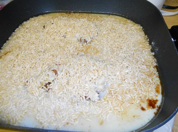 Pour soup mix over chops in skillet; add rice. Add one soup can water....