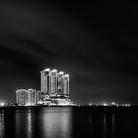 Pantai Indah Kapuk. by Andy Prasetyo - Black & White Buildings & Architecture ( architechture, black and white, bw, fine art, jakarta, beach, architecture, landscape, beaches, blackandwhite, night photography, indonesia, buildings, cloudy, long exposure, clouds, building, sea, architectural detail, nightscape, fineart, cloud, landscape photography, architectural, night, landscapes, longexposure )