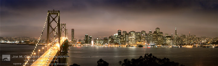 Photo: Re-emerging From the Storm Evening glow of traffic on the Bay Bridge and skyscrapers making up the San Francisco skyline. This digital panoramic photo was made from 6 images. Nothing like some good stormy weather to add drama to a cityscape photo.