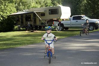 Photo: Derek Stark, 4, and Zachery Stark, 6, bike near their family's camper at Grand Isle State Park. Photo by Karen Pike.