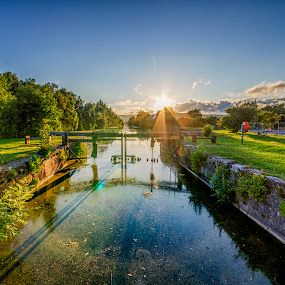 Canal Sunset by Graham Kidd - Landscapes Sunsets & Sunrises ( water, green, sunset, trees, reflections )