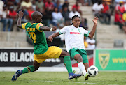 Siyethemba Sithebe of AmaZulu tackled by Nkosinathi Sibisi of Golden Arrows during the Absa Premiership 2018/19 match between Golden Arrows and AmaZulu at the Suger Ray Xulu Stadium, Clermont on the 14 April 2019.