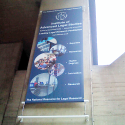 a promotional banner hanging on a wall