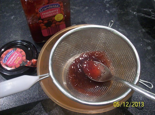 Put the 2 spoonful of jam into small bowl and heat in the microwave...